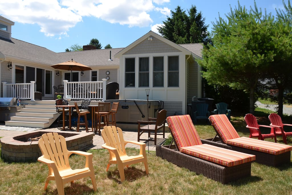 Large deck with hot tub, firepit, patio, lg stainless grille, and plenty of seating.
