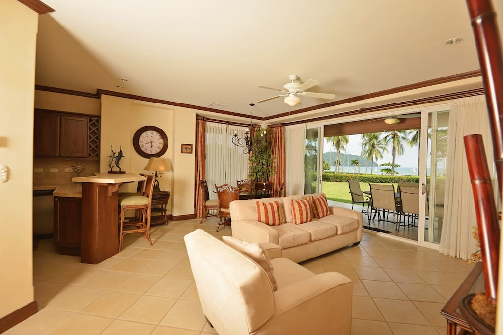 Open living room space, with ocean view and large graden.