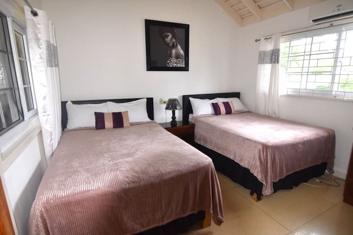 Bedroom two with wifi and cable curved tv air conditioning ensuite bathroom with shower