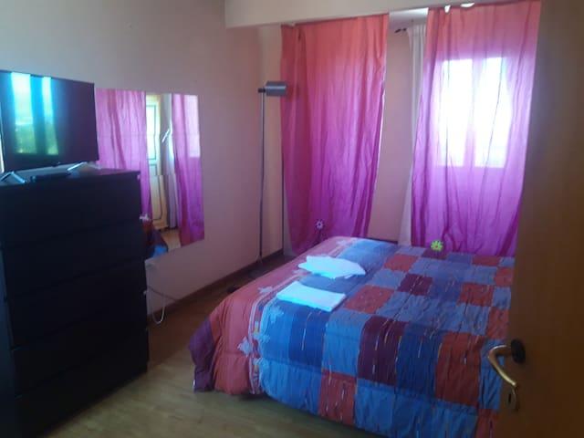 Affitto stanza con letto matrimoniale e bagno