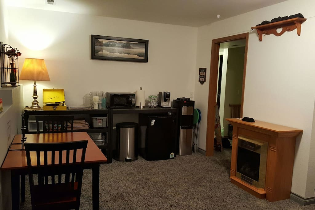 kitchenette with microwave, coffee maker, complimentary coffee and tea, water cooler with hot/cold water. dinging table and fireplace!