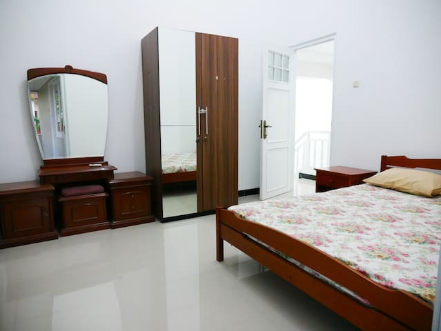 Second bedroom (2nd C:\Users\diosk\OneDrive\Personal Files\Project BUKUfloor) with a double bed. This room is air-conditioned.