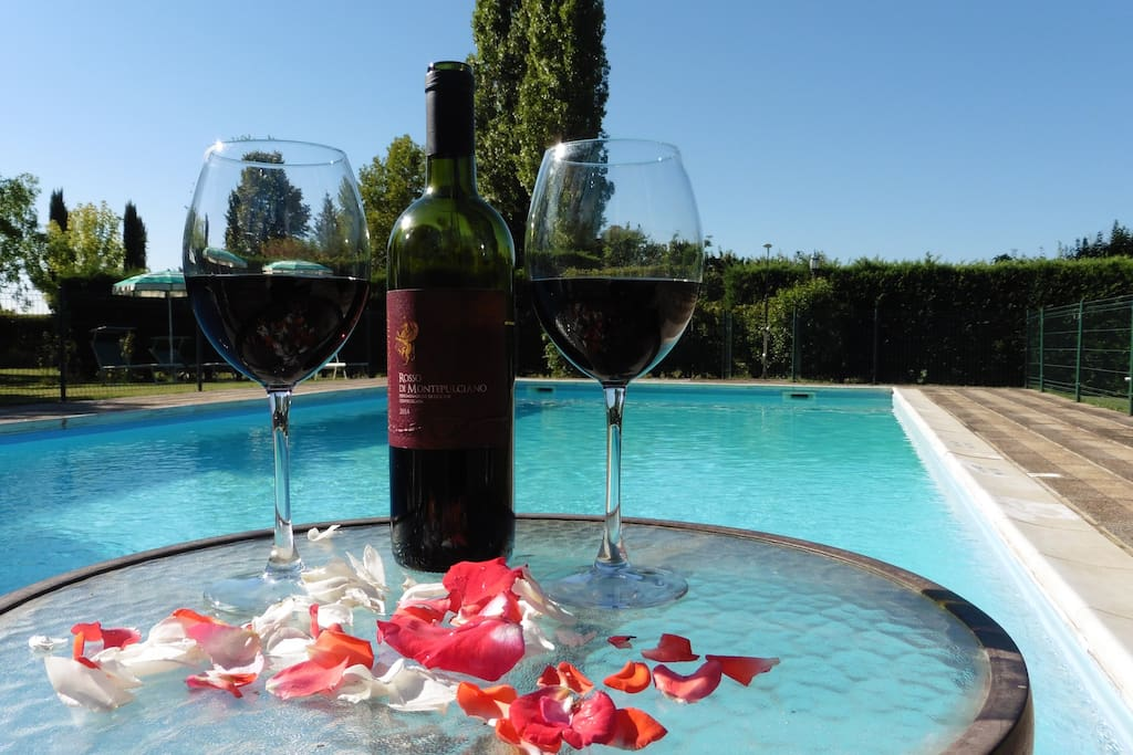 Glass of wine by the pool