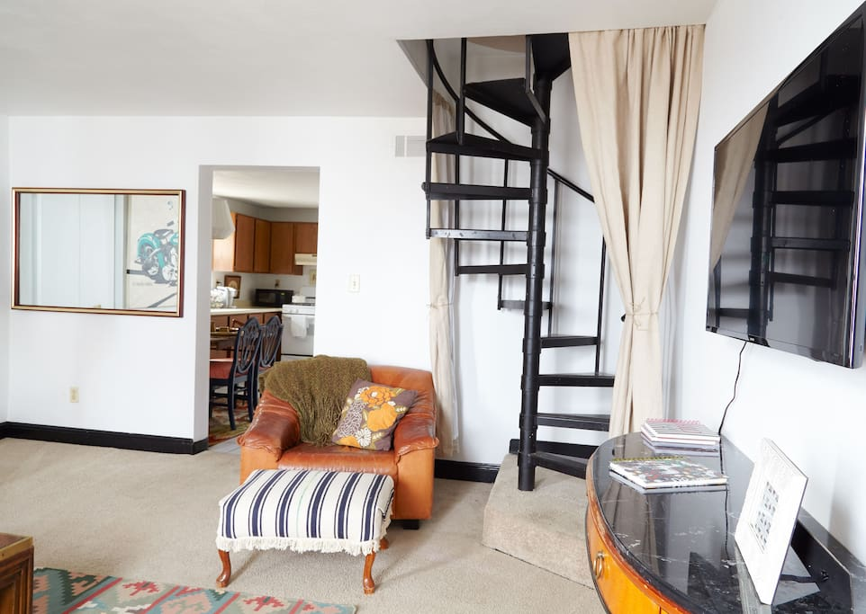 Apt 3 - Living Room, spiral staircase to bedrooms and full bath