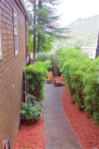 Walkway along the side of the house to the hot tub.