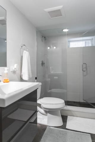Private bathroom with walk in shower & plush towels