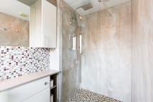 Master bedroom en-suite dual head drench shower