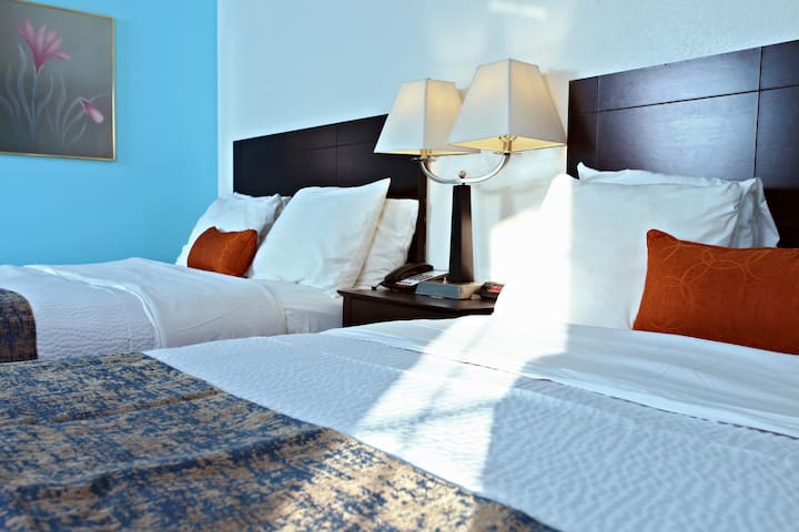 We invite you to try it. Sky-Palace Inn & Suites-Nonsmoking 2 Double Bed