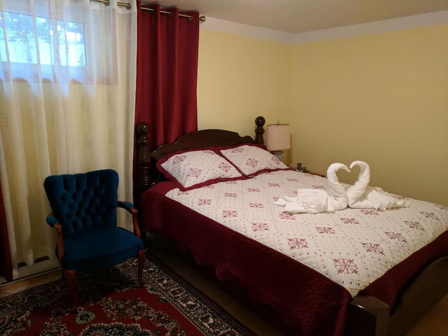 The yellow bedroom: a very comfortable queen bed; closet on the left