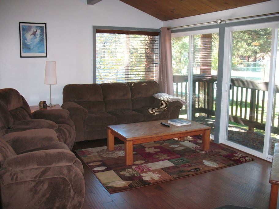 Cozy couch and dual electric recliners (recline at the touch of a button). Lots of natural light or use the blackout curtains and privacy blinds.