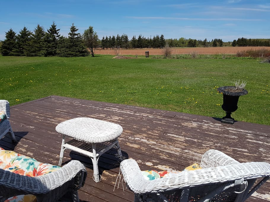 Beautiful view from back deck. Quiet setting - backing onto farmer's potato field. Beautiful for watching sunsets.