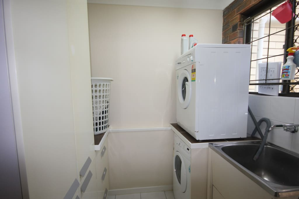 Laundry has two front loading washing machines