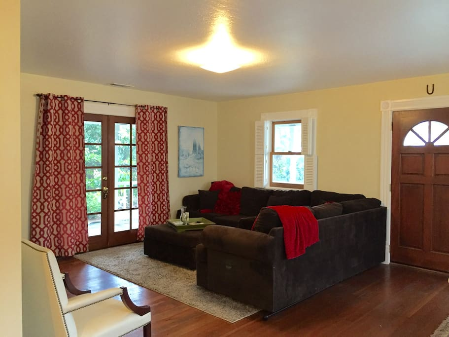 Living room with huge sectional couch. So comfortable you may not want to leave. Snuggle up with the heater and new throws; perfect for movie Night.