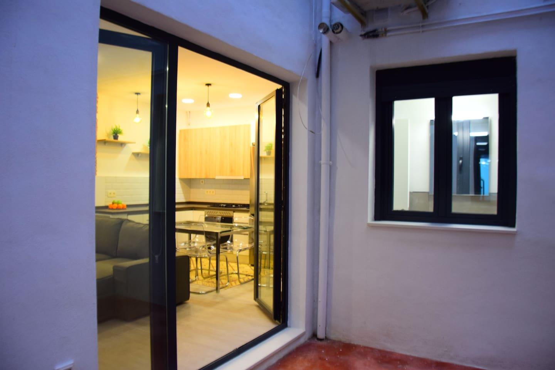 Salon / Cocina y patio