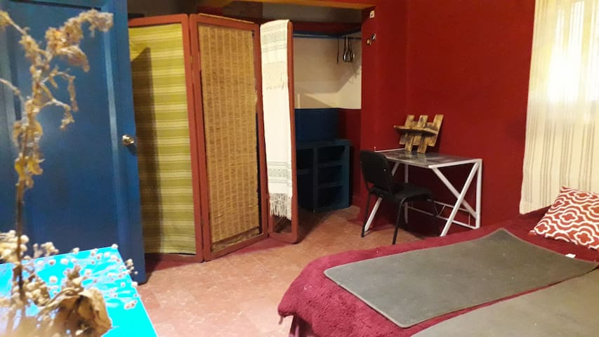 The 'Tibet' room and  'Whale' room share a connecting door which can be unlocked and opened for use like an independent small appartment.  It might work well for a family with young kids who would have a bedroom, come play space of their own.