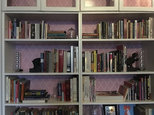 If you're a bookworm, you'll love perusing our wall of books. (Help yourself!)