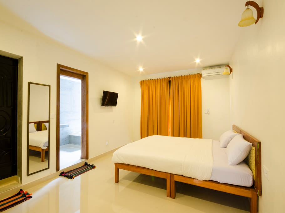 Bright and large bedroom with extra-long bed ( 2x2.4m), Wardrobe, air-condition, flat screen TV, safety box,