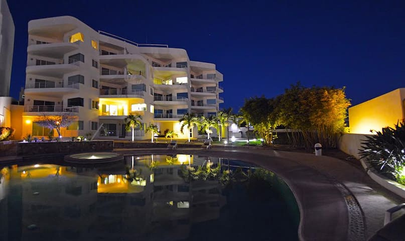 Evening view of the building from pool area.