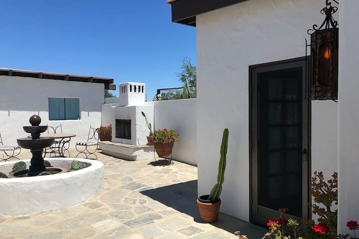 Private courtyard with fireplace, fountain, tiled table and gorgeous views to the surrounding hillsides.
