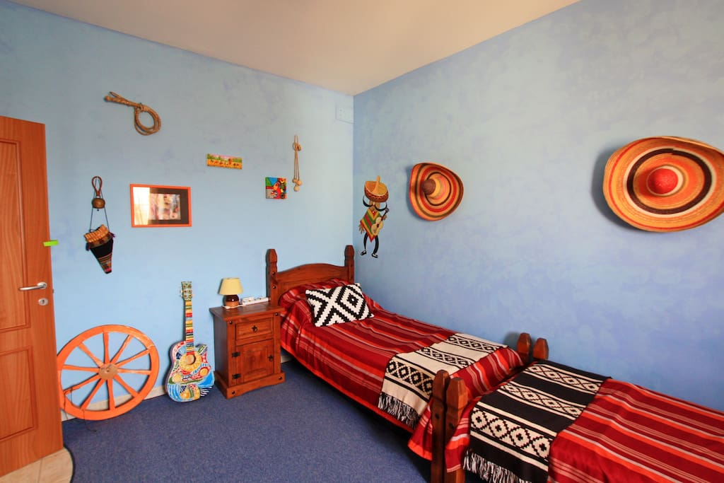the room with two single beds - Mexican room