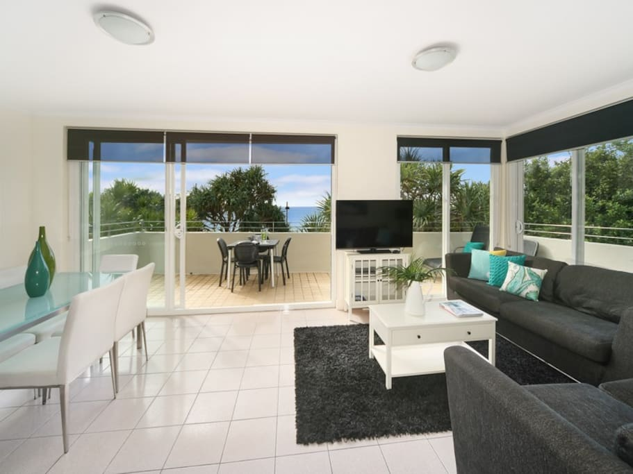 Lounge room with full view of Noosa Main Beach. Air con.