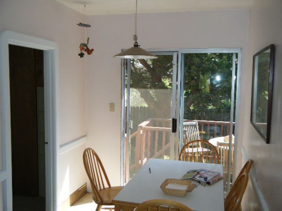 Kitchen opens up to sunny deck