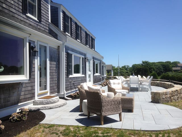Outdoor Stone Patio Overlooking Ocean Harbor, Dining Table, Conversation Set/Loveseat, 2 Chaise Lounges.  Perfect for Entertaining!
