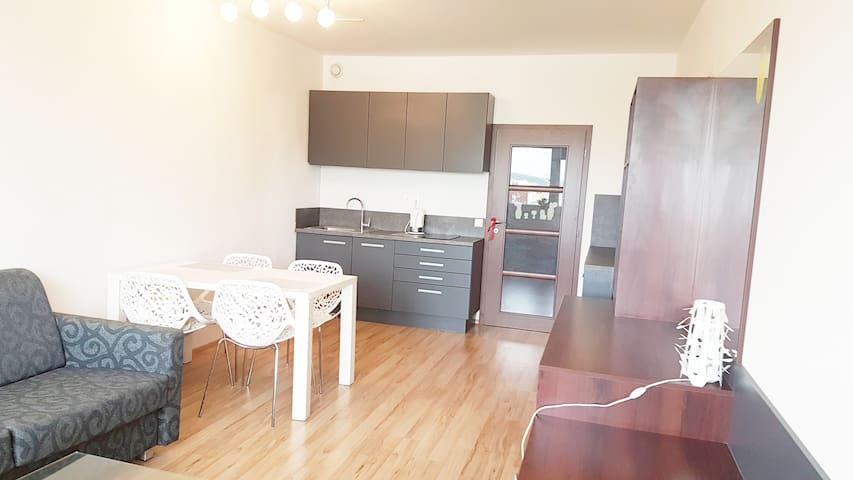 Modern apartment by subway and O2 Arena / Clarion
