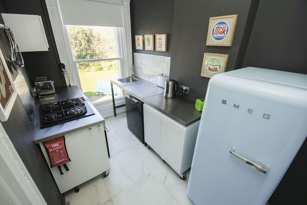 The baby blue Smeg fridge is the focus for this kitchen...but there's also a Nespresso coffee machine, Baumatic appliances & a dishwasher here