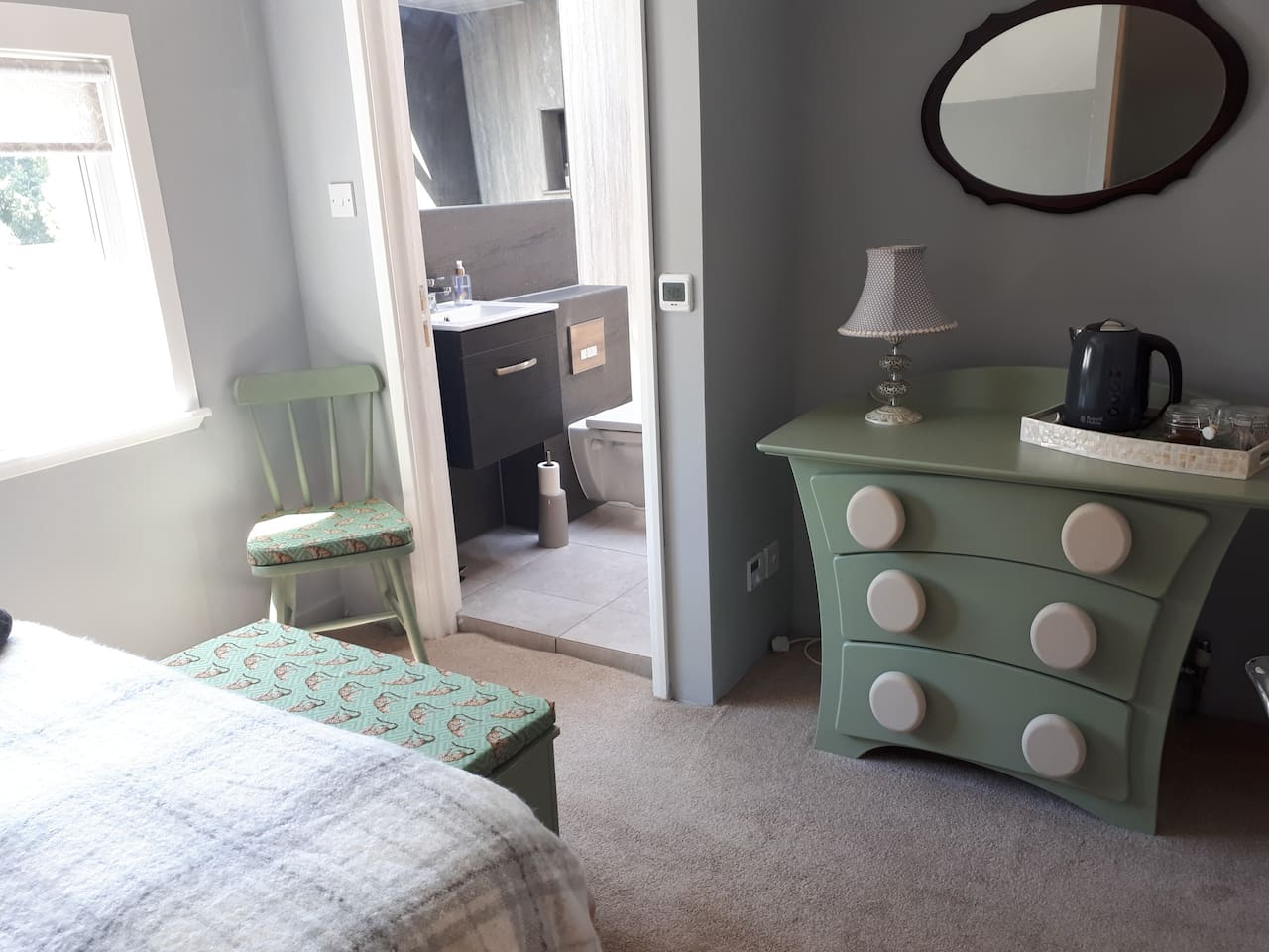 A warm and cosy guest bedroom with en suite.