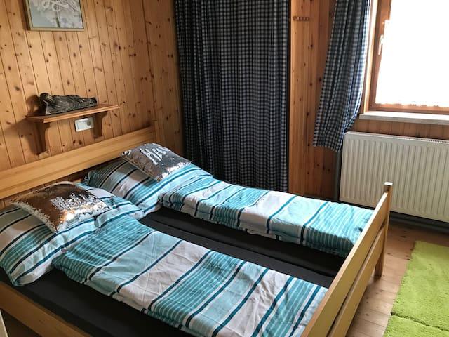 Schlafzimmer im Apartment Hochfichtblick