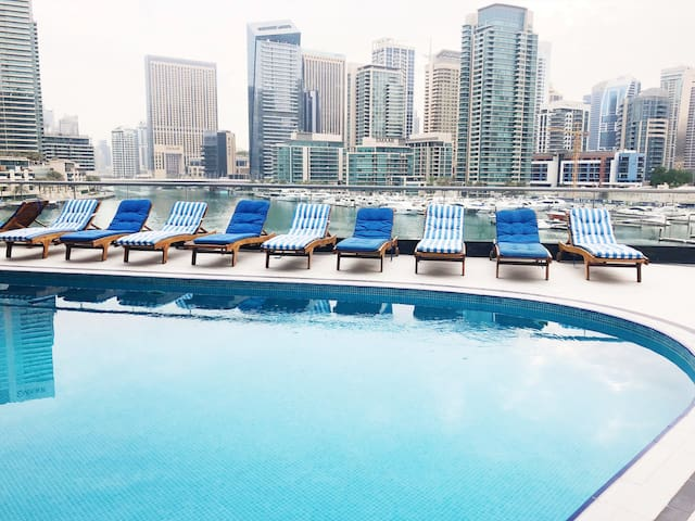 Welcome to LOS Dubai. Starting off with the iconic view of Dubai Marina from the pool area. Here you'll find 2 pools, 1 jacuzzi and a large picnic area.
