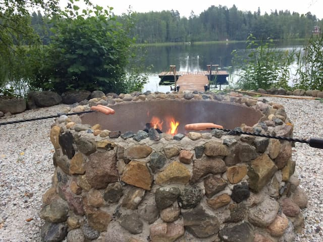 The campfire and roasting finnish sausages!