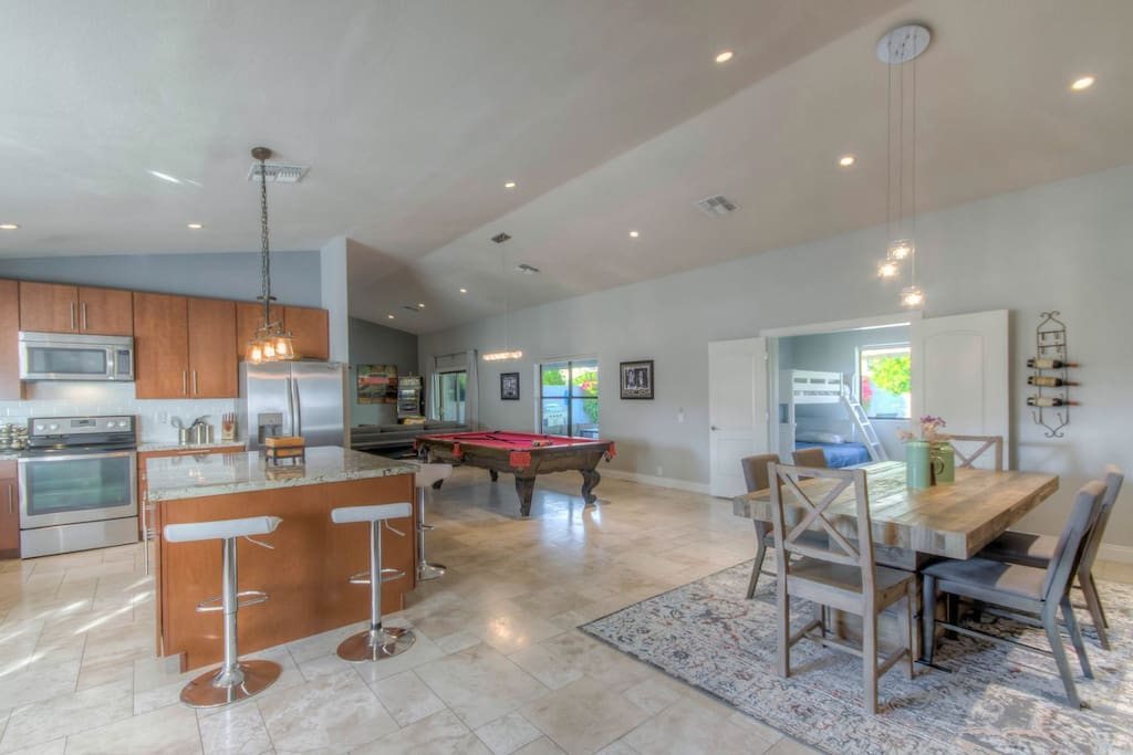 HUGE open floor plan with kitchen, dining, and living combined perfect for entertaining any size group!