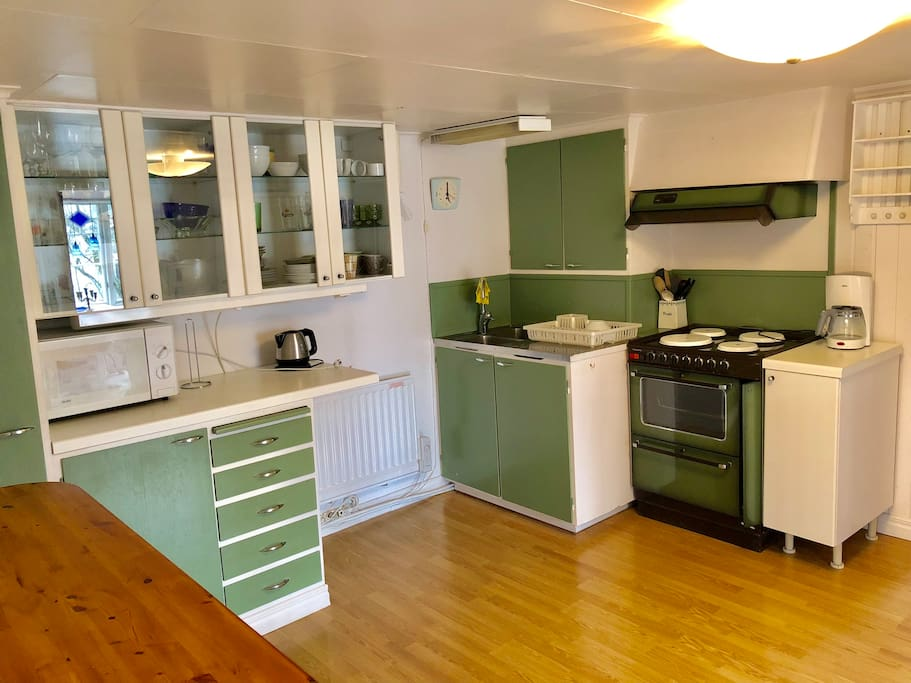 Kitchen including oven, microwave oven, freezer and fridge.