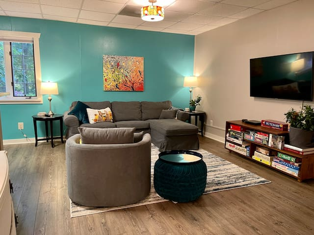 """The spacious open concept floor plan offers a lot of room for a couple or small family. With seating for 4, a 50"""" HDTV (with house Netflix account), lots of board games, fast wifi, on-site trails and a huge yard there's plenty to do, too!"""