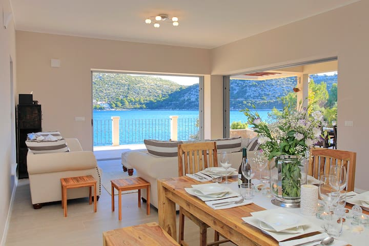 Luxurious beachfront villa with pool