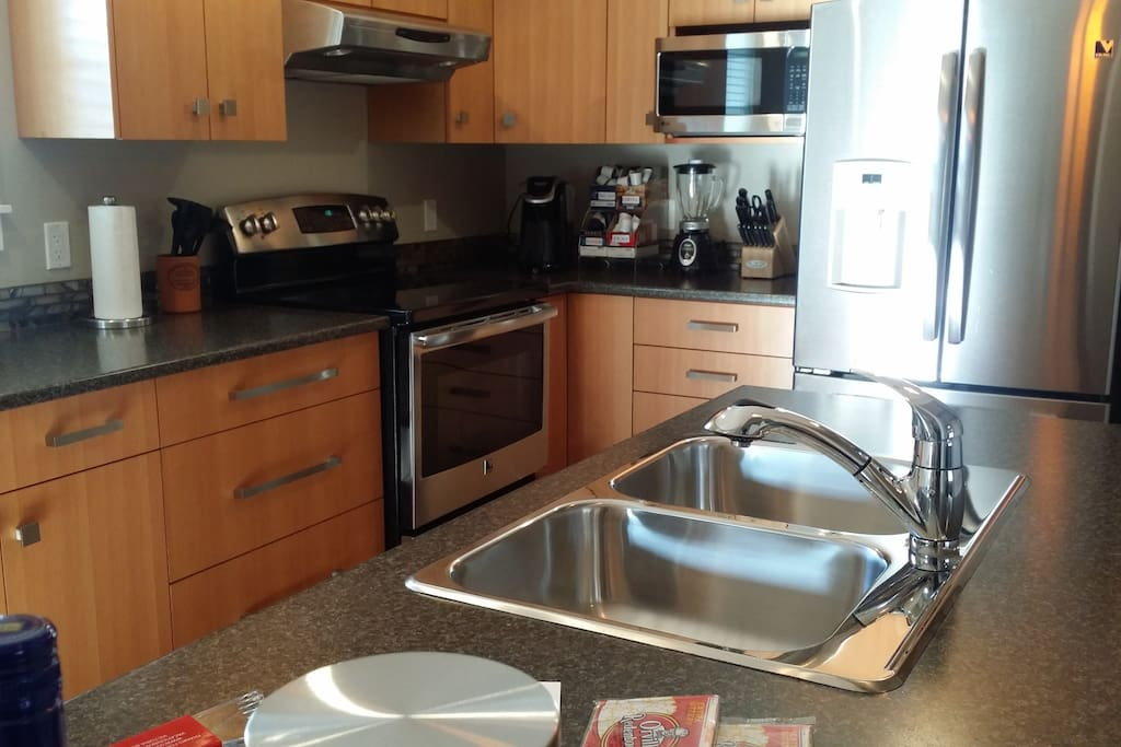 Full sized - amply stocked kitchen.