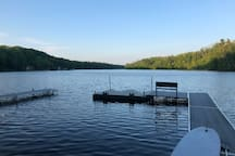 Two full docks with Jet Ski parking and a bench