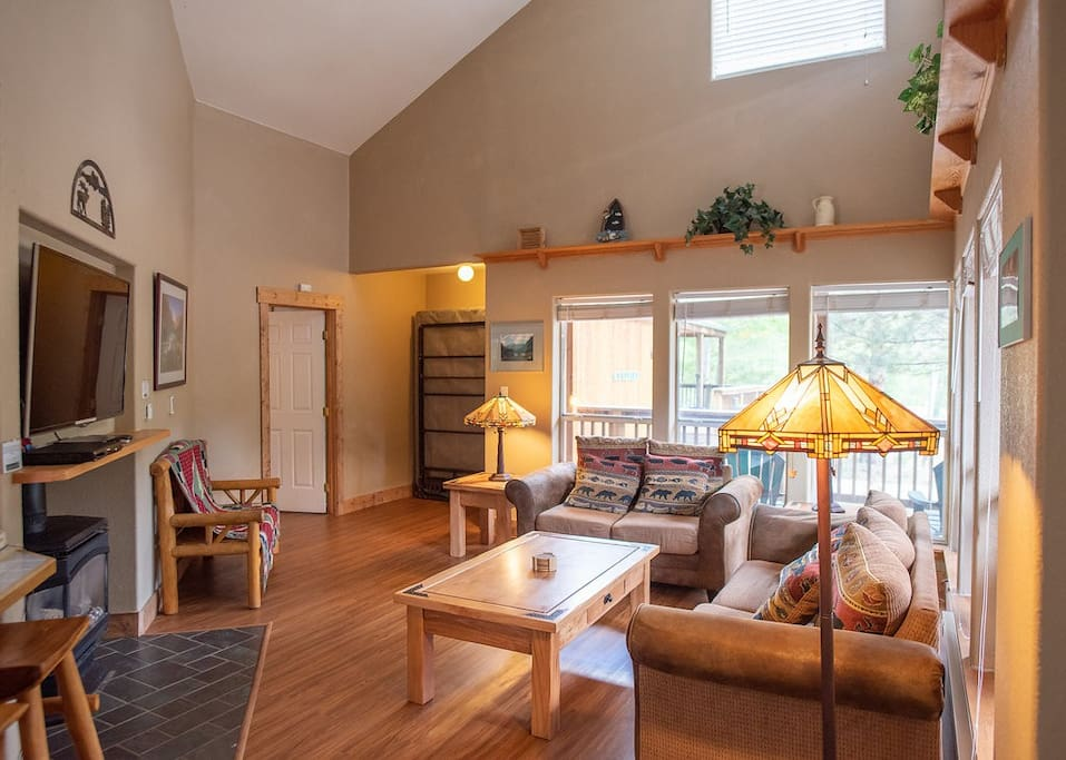 The vaulted ceilings and natural light make this living room ideal for relaxing in front of the gas fireplace and TV.