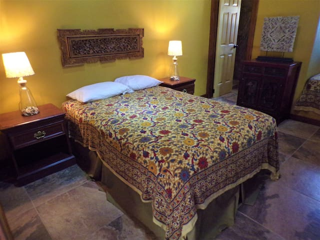 Room 7 features a queen bed and a double bed, ceiling fan and a private bathroom.