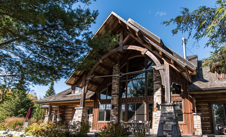 Stunning Log Cabin on 123 Acres