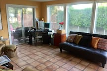 Bonus! Shared sunroom/office to use!