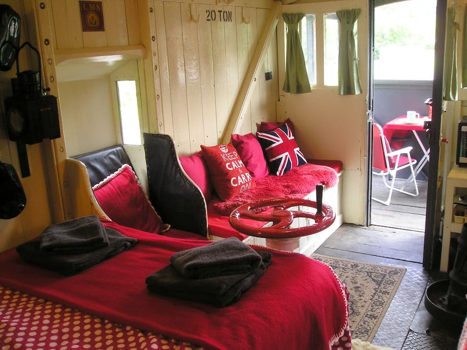 There is additional storage under the sofa and there is outside space on balconies at both ends of the carriage.