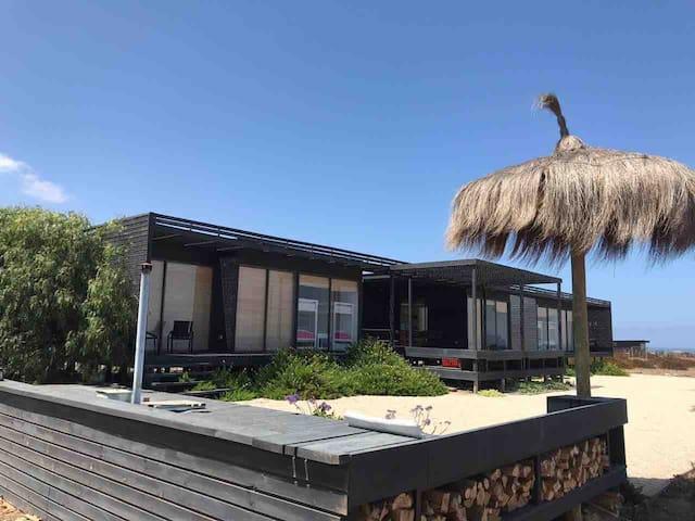 Playa, hot tub y atardeceres en Huentelauquén.