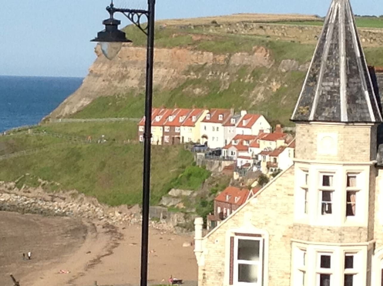 Great view across the beach and harbour towards the abbey.