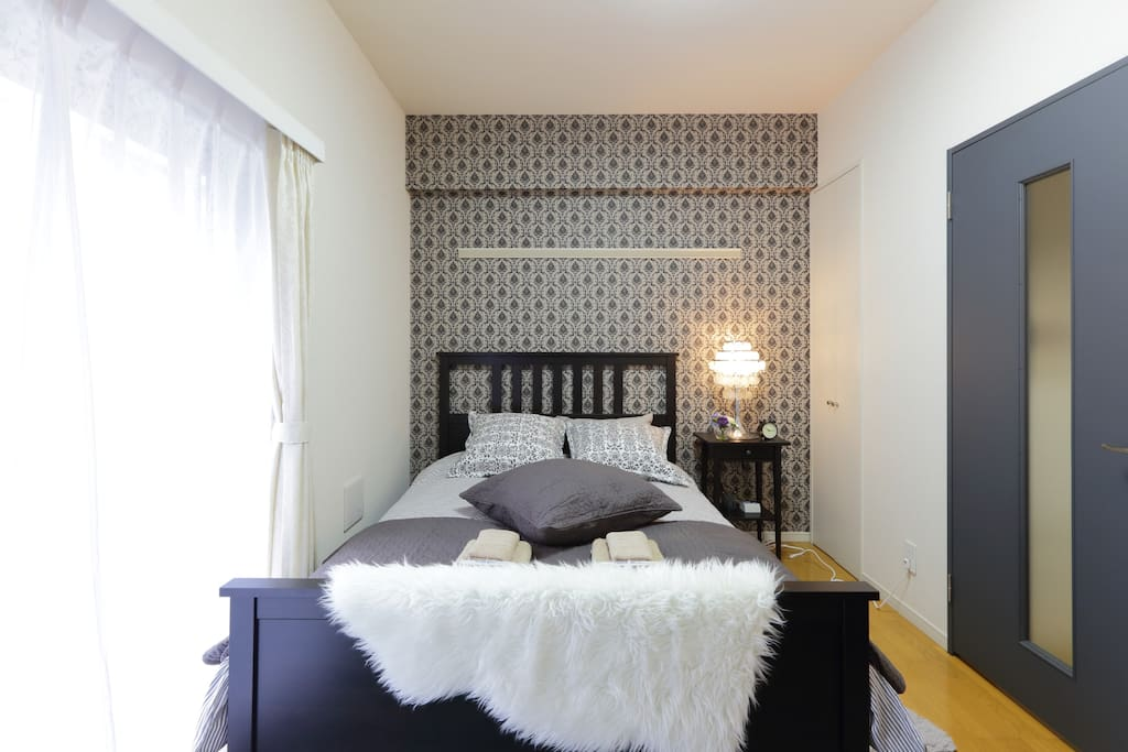 Studio apartment with one double bed and one single futon set