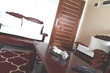 Living room with TV and free wifi available. You can watch your favourite channels