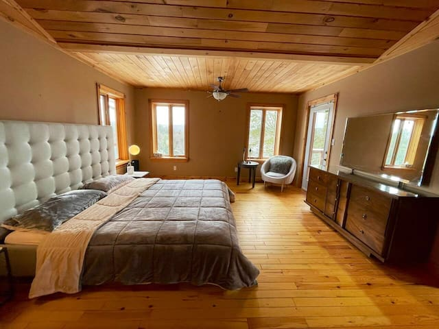 Master bedroom on main level with private balcony