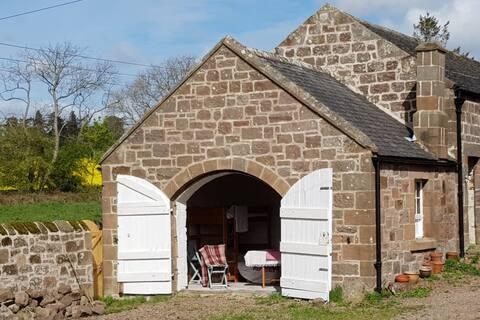 The Bothy. Cosy, eco friendly barn camping.